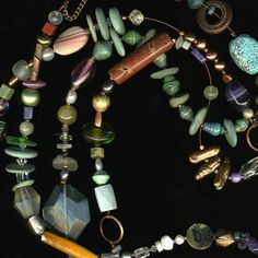 "Long multi strand stone collage necklace by Shelly Daly  ""Beach stones are drilled & used as beads ,& collaged with other earth-bound elements like turquoise, crystals, amethyst & wood. They are strung on copper. 34"" long with a clasp allows for wrapping into a choker."""