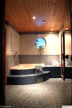 kylpyhuone,laatat,saunatila,pyöreä ikkuna,poreallas