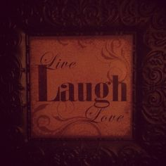 This hangs over my bed to remind me each morning to Live Laugh Love :)