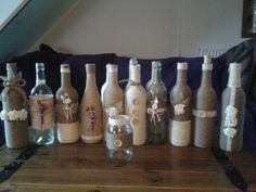 Twine covered wine bottles that I made this week.