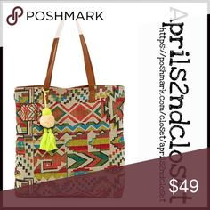 """Pom Pom TOTE Woven Bag NEW WITH TAGS  Pom Pom TOTE Woven Bag   * Boho tribal print & a detachable Pom Pom bag charm ; Faux leather like trim   * Dual top handles & magnetic button closure   * Approx 10"""" handle drop   * Approx. 15"""" H x 16"""" W x 3"""" D   * Interior features 1 wall zip & 2 media pocket   * A semi firm structure style   Material: Textile & PU exterior, polyester lining  Color: Multi   Bucket No Trades ✅ Offers Considered*/Bundle Discounts✅  *Please use the 'offer' button to submit…"""