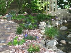 Redoing flower beds, would love to use rock instead of mulch. Love this rock. Redoing flower beds, w Landscaping With Rocks, Landscaping Tips, Outdoor Landscaping, Outdoor Gardens, Garden Stream, Water Garden, Rock Wall Gardens, Peonies Garden, Flowers Garden