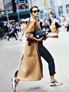 Long camel coat and a quilted purse