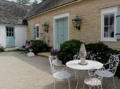 Like the painted stone/brick color and the door color --designer Suzy Stout's French Country Farmhouse