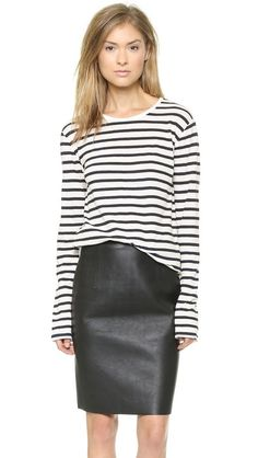 Team stripes with a leather pencil skirt for a casual cool look / the love assembly