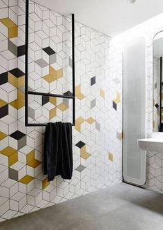 geometric tile white yellow and gray block tile in bathroom