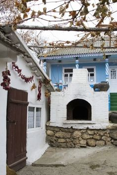 Beautiful blues, an outdoor fireplace, and chilis drying out. This is a typical front yard in Moldova. Click through to see more Front Yards from Around the World. Places Around The World, Travel Around The World, Around The Worlds, Europe Travel Guide, Travel Info, Worldwide Travel, Wanderlust Travel, Cool Places To Visit, Day Trips