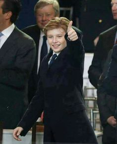 I HAVE REALLY TRIED HARD NOT TO CALL TRUMP SUPPORTERS NAMES, BUT IF YOU THINK DJT IS AN AWESOME PERSON, YOU'RE A FUCKING IDIOT!! Hopefully this kid doesn't grow up to be a pompous ass like his father and older step-brothers.  *Original comment on pin --> Love this picture, thumbs up just like his awesome dad! Baron Trump what a great kid!