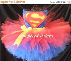 Baby Petti Tutu Dress The bodice is blue with a red and blue tulle skirt. This beautiful baby Petti Tutu Dress is custom designed and hand made with super soft quality tulle and has a felt superman logo on the belly. It is made with red and blue colored tulle. Extra fluffy! It is the perfect outfit for your little one to wear for pictures, birthday party, Halloween or to simply wear and look great! SIZING * this dress can be made any size newborn thru 10 years. Baby Tutu Skirt is…