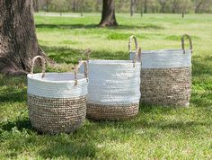 Show off your nautical survival skills and knowledge of knots with a trio of shoelace and raffia woven baskets with handles that will keep your space looking smart and ship-shape. Dimensions:14.75-16.