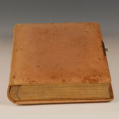 A Russian suede leather photograph album containing 35 photographs of various family members of Eleanor Thiess (1901-1987) and her twin sister Irene Thiess, who were Russian immigrants who fled to Finland in 1916.