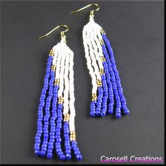 Very classy handmade seed bead earrings. These are made by weaving seed beads together in these elegant colors of blue, white and a touch of gold. The flat edge that occurs at the bottom of the fringe gives these earrings an added special uniqueness. They are very light weight for comfortable wear. Pierced earrings come with a clear plastic backing highly effective in preventing loss of earrings. Ear wire can be exchanged to clip on style or gold plated brass lever back style finding if…