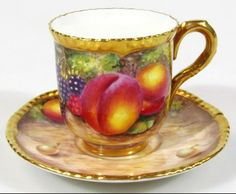 Royal Worcester hand painted fruit pattern cabinet cup and saucer,