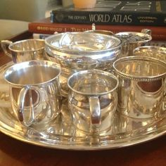 Saw this at my friend Anna Rich's house. What a fabulous way to display the silver baby cups, porringers and rattles after they are no longer used. Silver Jewellery Indian, Silver Jewelry, Gold Earrings Designs, Jewellery Designs, Jewellery Display, Vintage Silver, Antique Silver, Silver Pooja Items, Silver Plate