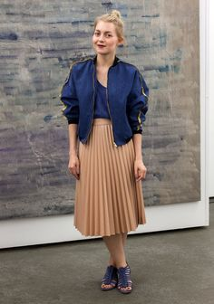 """""""I'm wearing anR/H bomber jacket, a skirt from Zara and a second hand silk top.At the moment I like midi-lenght and high-waisted skirts, lipstick and mixing dark colours with something summery. Samuji is my favourite fashion brand."""""""