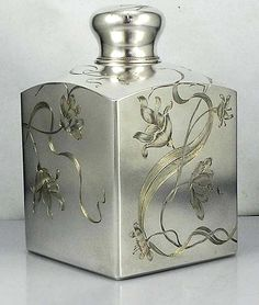 Russian antique silver tea caddy with hand engraved art nouveau decoration.
