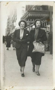This is a picture of my mother, Pauline (Baker) DeRoche, and her friend, Helen Heid, walking down the street in downtown Syracuse, probably in 1938 or 1939. I just love the way they dressed and walked, arm in arm. I'm not sure who took the picture or what street it is. This is definitely a reflection on the history of downtown Syracuse!! If anyone could possibly help name any of the stores in the picture, that would be great!!! This was WAY before my time!