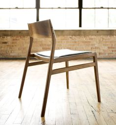 C03 - Dining chair with solid wood back and upholstered seat. Shown in black walnut. By Jason Lewis Furniture