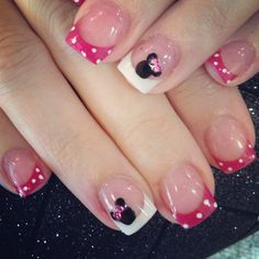 Minnie Mouse nails with rhinestone pink bow.