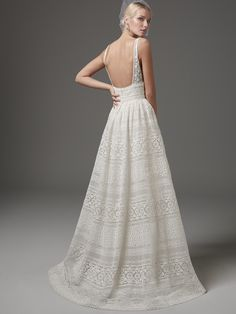 Sottero and Midgley - EVAN, This chic, boho-inspired wedding dress features sheer pockets and patterns of eyelet lace, floral motifs, and scalloping. Sheer lace straps complete the V-neckline and sexy square-back. Finished with zipper closure. Detachable tulle overskirt with lace waistband sold separately.