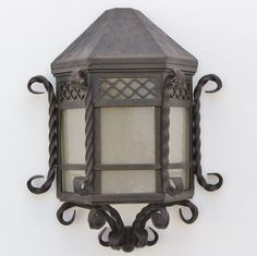hand forged exterior lighting. suitable for hallways or areas where the lighting fixture should have minimal projection from wall. made real heavy duty hand forged wrought iron. exterior f
