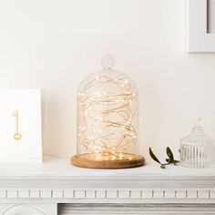 Create a truly magical display in your home with our elegant glass bell jar filled with copper micro LED fairy lights.A stunning party table centrepiece or mantelpiece decoration, this 21cm tall dome gives an enchanting glow when illuminated. The copper wire is so on trend and can be shaped as desired. There's a groove in the wooden base so you can easily trail the wire and tuck your battery box out of sight. The 50 micro fairy lights require 3 AA batteries (not included) and feature a ...