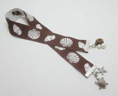 White Sea Shell Print Brown Ribbon Bookmark by WhispySnowAngel, $10.00 - This, but in a camera strap!!!