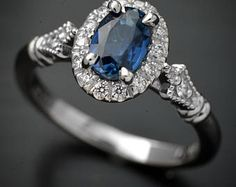 14kt white gold engagement ring with a Natural blue Ceylon Sapphire on a cushion halo micro pave