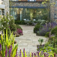 A large family Guernsey Garden in the Channel Islands. Acres Wild Country Garden Designers and Master Planners. Small Country Garden Ideas, Garden Ideas Uk, Garden Inspiration, Small Mediterranean Garden Ideas, Back Gardens, Small Gardens, Outdoor Gardens, Back Garden Design, Garden Paving