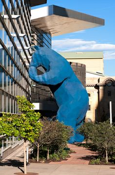 "This is the Big Blue Bear in Denver we mentioned, by artist Lawrence Argent (official name:  ""I See What You Mean"").  We didn't take this photo; it's courtesy of the Denver Convention Center folk (so many thanks, y'all!).  Now you can see what we meant when we said the bookend at the AIPAD Show looks like this, only straighter (and smaller).  If you ever go to Denver (and we greatly recommend it - a wonderful place!), go to the Convention Center and check this out.  Say ""Hi!"" to the bear for…"