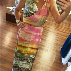 Beach scene maxi dress Stunning, silk maxi dress! Has a perfect beach scene print that is perfect for any summer occasion!! Has sexy slit on one side! Amanda Uprichard Dresses Maxi