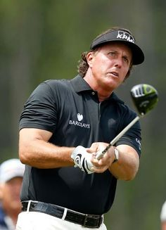 """Phil Mickelson and his one of two 3-woods he carried this week on the seventh hole Sunday. He promised to unveil a """"special club"""" Monday for the Masters."""