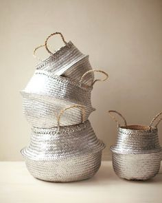 Spray painted straw baskets from Martha Stewart using Krylon premium metallic spray paint, in Sterling Silver.