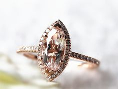 This blushing marquise-cut morganite ring surrounded by diamonds: