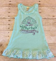 The Girl who has everything! Mermaid Dress in Mint Green  This lace tank dress is perfect to make your little girl sparkle! A soft stylish tank dress has lace-trimmed at the neck and hem for a total trendy look. Made of cotton/poly 1x1 rib for a super-soft feel.  Your little princess will be sure to steal many hearts in this outfit!!  This design can also be put onto a tee. please send me a message to inquire!  I only use quality heat transfer vinyl on all of my products.  We are a 5 star…