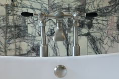 Mixing the natural and the man-made. Contemporary Brushed nickel bath fittings set against the Georgica Pond Marble tiles from Fired Earth, work in harmony in this altogether grown-up bathroom. Architects Near Me, Budleigh Salterton, Fired Earth, Newquay, Marble Tiles, Interior Design Services, Brushed Nickel, Home Remodeling, Interior Architecture