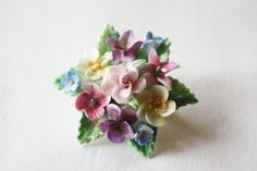 """Porcelain floral brooch by """"Crown"""" of Staffordshire, England."""