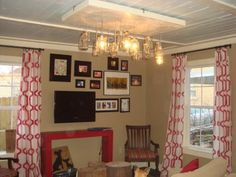 Old mason jars of differing sizes and patterns turn into an charming light fixture