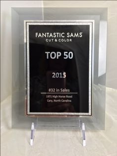 Blue Ribbon etched 100 Glass Plaque awards for Fantastic Sams to reward the top salons in 2014 and 2015. Acrylic Award was presented to the best franchise Sam Murray. #BlueRibbon #plaques #Acrylic #trophies