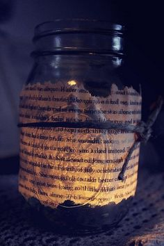 Book page jars with candle inside.  Old hymn book??  Line down table for Christmas. crafty