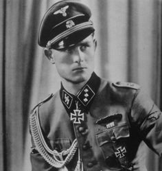 "SS-Untersturmführer Werner Wolff photographed with the Knight's Cross in 1943. Wolff, the battle-tested adjutant to Joachim Peiper (III./SS-Panzergrenadier-Regiment 2 ""LAH""), took over a leaderless company, following the wounding of its commander, and stopped a massive enemy tank attack in which thirty Soviet tanks were destroyed in close combat during Operation Zitadelle in July 1943. Wolff destroyed one tank with hand held explosives and refused to give ground to the Soviet attack."