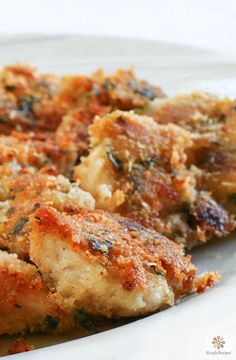 Baked Parmesan Chicken Nuggets ~ The best Parmesan Chicken recipe ever! Chicken parts dipped in melted butter, dredged in bread crumbs and Parmesan, and baked until crisp. ~ SimplyRecipes.com