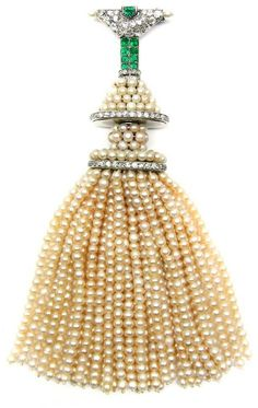 Platinum, pearl, diamond and emerald tassel brooch by Cartier, Paris.