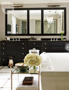 Chic #Bathroom. Love the chandelier above the tub.