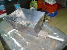 Handmade coal forge using the v-shaped design. He describes it in more detail on the forum.