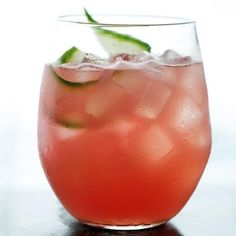 5 cups cubed seedless watermelon (about 1 1/2 pounds) 1 large English cucumber, peeled and cut into chunks 1/4 cup fresh lime juice (from 2 limes) 2 tablespoons honey 2/3 cup vodka Ice Cucumber slices, for garnish.