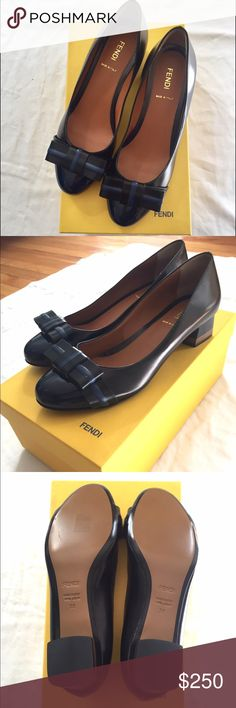 FENDI flats Classy & elegant FENDI flats. Navy Blue & Black with a bow on top. Size 38 and comes with navy blue dust bag. Never been worn!! Fendi Shoes Flats & Loafers