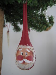 This ornament was made by my friend, Jean Poole. The Santa is painted on a fishing sinker. When she showed these ornaments to her kids when they were young they said they looked like snot.  I think I bought all of them that she had.  I have always love Custom imprinted ornaments for your church, business or organization