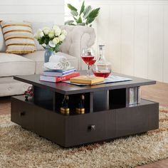 Enhance your entertainment area with this distinctively tiered and functional coffee table. The lifted tabletop sits upon paneled dividers that create spacious open shelves while balanced upon four drawers acting as the foundation.