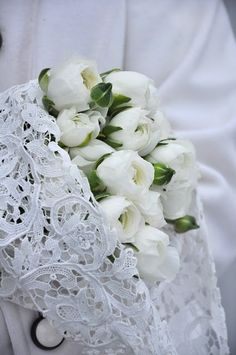 White ranunculus wrapped in white lace